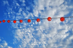 Red lanterns on a background of blue sky Royalty Free Stock Image