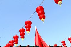Red lanterns in blue sky stock images