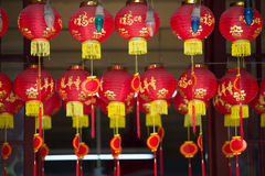 Red lanterns with gold lettering in a temple Stock Images
