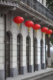 Red lanterns hanging on building. A gray building hanging some red lantern for holidays Stock Images