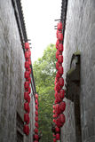 Red lanterns hanging on the wall Stock Photo