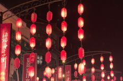 Red Chinese lanterns lit at night China. Red Chinese lanterns on a food street within the city of Luoyang China at night royalty free stock photo
