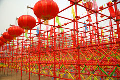 Red lanterns and red scaffold Stock Photo