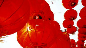 Red lanterns tassel swaying in wind,behind sun,elements of East,china new year. stock video