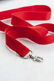 Red lanyard with metal carabiner. Stock Photos