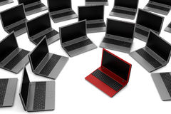 Red laptop among gray similar isolated Stock Image