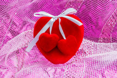 Red large heart with two small heart in pink background Royalty Free Stock Images
