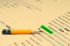RED - Las palabras destacan en el libro y el lápiz Fotografía de archivo