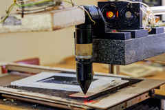 Red laser on cutting machine Stock Photos