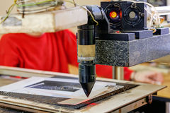 Red laser on cutting machine Royalty Free Stock Image