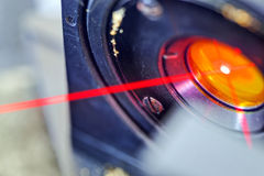 Red laser in laboratory. Red laser on optical table in physics laboratory royalty free stock images