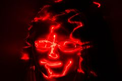 Red laser sketch contours of a girls face with glasses. On dark background vector illustration