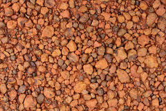 Red laterite gravel for background Royalty Free Stock Image