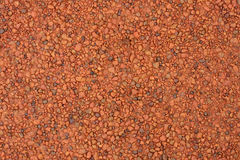 Red laterite gravel texture for background.  Royalty Free Stock Image