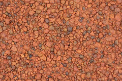 Red laterite gravel texture for background.  Royalty Free Stock Photography