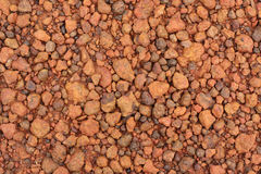 Red laterite gravel texture for background.  Royalty Free Stock Photos