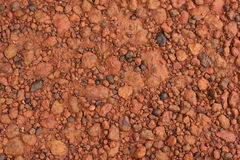 Red laterite gravel texture for background Royalty Free Stock Images