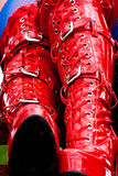 Red latex boots. Red latex fetish kinky boots with some metal buckles stock images