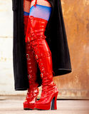 Red latex boots. Kinky red latex fetish boots on high heels stock image
