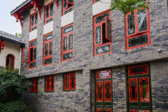 Red latticed windows of Chinese archaised building Stock Photo