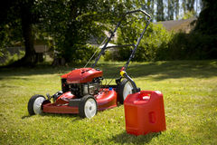 Red Lawn Mower. A red lawn mower and gas can in fresh cut grass Royalty Free Stock Images