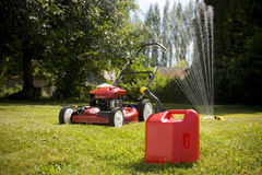 Red Lawn Mower. A red lawn mower and gas can in fresh cut grass Stock Images