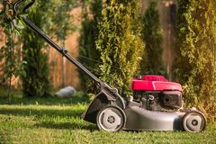 Lawn mower cutting grass Royalty Free Stock Photography