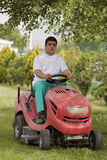 Red Lawn mower cutting grass Stock Photos