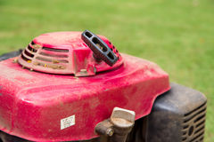Red lawn mower on golf course. Stock Photos