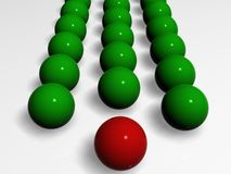 Red leader. Green balls follow for Red ball-leader Royalty Free Stock Image