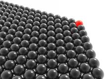 Red leader of balls group. Red leader of black balls group (hires 3D image Stock Images