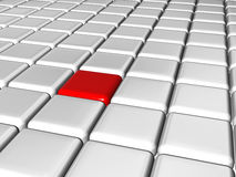 The red leader in the center of the group. Arranged 3d white-grey cubes with one red in the center of the group Stock Photography