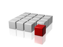 The red leader in front of the group. Arranged 3d white-grey cubes with one red in front of the group Royalty Free Stock Image