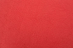 Red leather. A red leather background with fine texture Stock Image