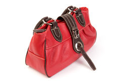 Red leather. Cute little red leather bag on a white background. Top view Royalty Free Stock Images
