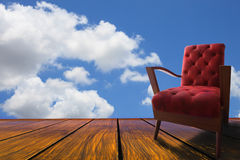 Red leather arm chairs on wood terrace Royalty Free Stock Images