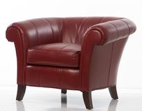 Red leather armchair. Expensive red leather armchair on white background Royalty Free Stock Image