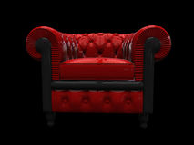 Red leather armchair front view. Front view of red glossy vintage armchair on black background Royalty Free Stock Images