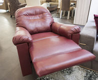Red leather armchair in show room Stock Images