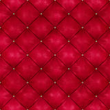 Red leather background with golden buttons Royalty Free Stock Photography