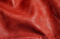 Red leather background. Background made of a closeup of wrinkled brown leather Royalty Free Stock Images