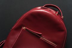 Red leather backpack on grey background Stock Images