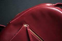 Red leather backpack on grey background Royalty Free Stock Photo