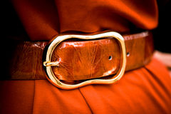 Red leather belt with a large buckle Stock Photos