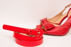 Red leather belt and shoes stock images