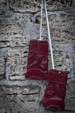 Red leather boxing gloves on the background wall Stock Photo