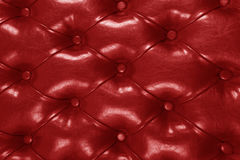 Red leather and button upholstery Stock Image
