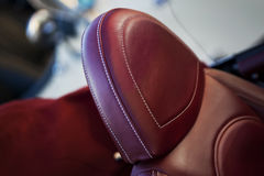 Red leather car seat stock image