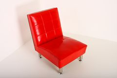Red leather chair. In an isolated corner Stock Photos