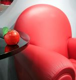 Red leather chair and apple Royalty Free Stock Images